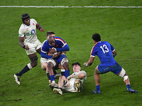 Rugby Union - 2020 Autumn Nations Cup - Final - England vs France - Twickenham<br /> <br /> France's Sekou Macalou is tackled by England's Owen Farrell and Tom Curry.<br /> <br /> COLORSPORT/ASHLEY WESTERN