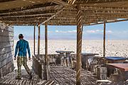 Man at Visitor centre at Salar de Atacama, Atacama Desert, Chile.
