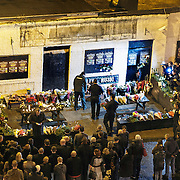 Clutha Vaults 1st Anniversary. One year on from the helicopter crash. A crowd gather outside the pub to mark the occasion and lay a wreath in memory of those killed.  Picture Robert Perry 29th Nov 2014<br /> <br /> Must credit photo to Robert Perry<br /> FEE PAYABLE FOR REPRO USE<br /> FEE PAYABLE FOR ALL INTERNET USE<br /> www.robertperry.co.uk<br /> NB -This image is not to be distributed without the prior consent of the copyright holder.<br /> in using this image you agree to abide by terms and conditions as stated in this caption.<br /> All monies payable to Robert Perry<br /> <br /> (PLEASE DO NOT REMOVE THIS CAPTION)<br /> This image is intended for Editorial use (e.g. news). Any commercial or promotional use requires additional clearance. <br /> Copyright 2014 All rights protected.<br /> first use only<br /> contact details<br /> Robert Perry     <br /> 07702 631 477<br /> robertperryphotos@gmail.com<br /> no internet usage without prior consent.         <br /> Robert Perry reserves the right to pursue unauthorised use of this image . If you violate my intellectual property you may be liable for  damages, loss of income, and profits you derive from the use of this image.