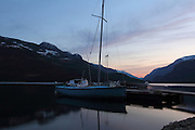 A boat moored on Upper Campbell Lake at Strathcona Lodge, Vancouver Island, at dusk