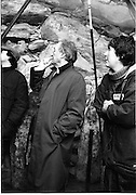 Taoiseach Visits Newgrange.  (R70)..1987..21.12.1987..12.21.1987..21st December 1987..An Taoiseach, Charles Haughey TD, visited the Newgrange Stoneage Chamber to view thwe annual Winter Soltice. As the sun rose, An Taoiseach watched as the sunrise traced its path along the floor of the chamber...Image shows An Taoiseach, Charles Haughey, inside the Stone age chamber as the sun traces its path through the chamber.