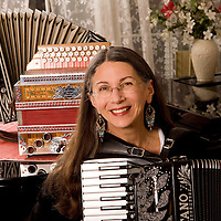Joan Grauman, plays her favorite acccordian in her Potomac, Md.<br /> home.<br /> ©Patrice Gilbert 4/30/2010