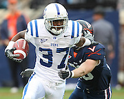Duke wide receiver Johnny Williams (37) runs past Virginia safety Ausar Walcott (30) during an ACC football game Saturday in Charlottesville, VA. Duke won 28-17. Photo/Andrew Shurtleff