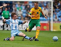 Photo: Richard Lane/Richard Lane Photography. Coventry City v Norwich City. Coca-Cola Championship. 09/08/2008. Coventry's Jay Tabb (lt) tackles Norwich's Sammy Clingan.