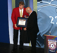 28 August 2006: Hall of Fame President/CEO Will Lunn (right) presents a plaque to 2006 Hall of Fame inductee Alexi Lalas (left). The National Soccer Hall of Fame Induction Ceremony was held at the National Soccer Hall of Fame in Oneonta, New York.