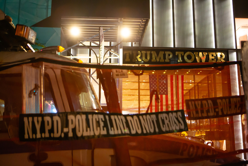 New York, NY - 3 November 2020. New York City anticipates presidential election results as polls in some states close. A police barricade formed my sanitation department trucks and police busses blocks access to Trump Tower on Fifth Avenue.
