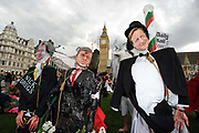Effigies of British Political leaders, Nick Clegg, Gordon Brown and David Cameron are placed in Parliament Square during a May Day demonstration, London.