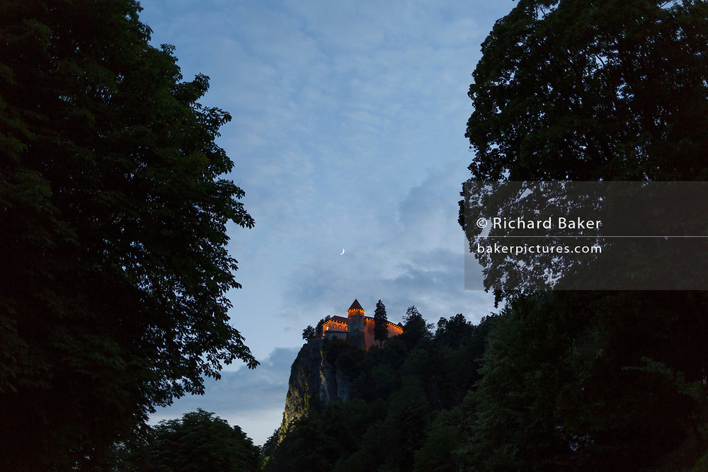 Bled Castle seen through trees on a summers evening, on 17th June 2018, in Bled, Slovenia.