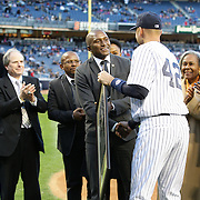 Derek Jeter presents Zondwa Mandela with a plaque honoring Nelson Madela watched by Rachel and Sharon Robinson during the New York Yankees V Chicago Cubs, double header game two at Yankee Stadium, The Bronx, New York. 16th April 2014. Photo Tim Clayton