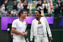 Venus Williams and Pat Cash at the end of the day on No.1 court at The All England Lawn Tennis Club, London.