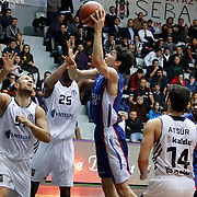Anadolu Efes's Cedi Osman (C) during their Turkish basketball league match Besiktas integral Forex between Anadolu Efes at BJK Akatlar Arena in Istanbul, Turkey, Monday, January 05, 2015. Photo by TURKPIX
