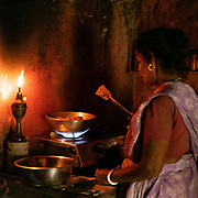 Cooking indian food in a traditional home.