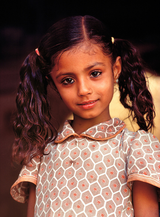 A young Rajasthani girl poses in a doorway in Jaiselmeer, India.