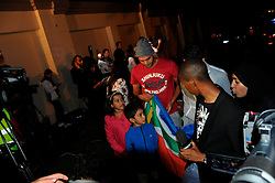 05.12.2013, Johannesburg, ZAF, Nelson Mandela, der Gigant des Humanismus ist im Alter von 95 Jahren in seinem Haus an den Folgen einer Lungenentzuendung gestorben, im Bild People gather outside the residence of former South African President Nelson Mandela // Nelson Mandela a giant of humanism died in his house in Johannesburg, South Africa on 2013/12/05. EXPA Pictures © 2013, PhotoCredit: EXPA/ Photoshot/ Zhang Chuanshi<br /> <br /> *****ATTENTION - for AUT, SLO, CRO, SRB, BIH, MAZ only*****