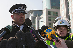 © licensed to London News Pictures. London, UK 16/01/2013. Commander Neil Basu of the Metropolitan Police (left) and Pauline Cranmer, Ambulance Operations Manager for the Ambulance Services (right) giving a statement about the helicopter crash in Vauxhall, London. Photo credit: Tolga Akmen/LNP