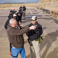 012513       Brian Leddy<br /> Ken Mickiewicz, an instructor with Front Range Training, works with Captain Rick White of the Gallup Police Department Thursday at the law enforcement gun range.