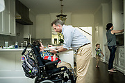 BIRMINGHAM, AL – AUGUST 26, 2018: Dr. Matthew Might feeds a snack to his son, Bertrand, at home. Formerly a strategic leader appointed to the White House Precision Medicine Initiative by former President Barack Obama, Might was named the inaugural director of the Hugh Kaul Personalized Medicine Institute at the University of Alabama at Birmingham School of Medicine. CREDIT: Bob Miller for The New York Times