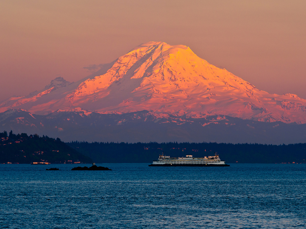 Mt. Rainier, with a summit elevation of 14,411 feet (4,392 m), dominates the Seattle - Tacoma skyline, and creates a stunning backdrop for Elliot Bay, as seen from Bainbridge Island.