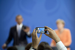 59860280   <br /> Barack Obama, president of the USA, and German Chancellor Angela Merkel (right) during a press call at a state visit of the Chancellery in Berlin, Germany. Barack Obama will walk in John F. Kennedy's footsteps this week on his first visit to Berlin as US president, but encounter a more powerful and sceptical Germany in talks on trade and secret surveillance practices. International Politics, Berlin, Germany on Wednesday 19 June, 2013. UK ONLY