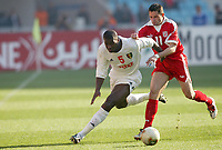 FOOTBALL - AFRICAN NATIONS CUP 2004 - FIRST ROUND - GROUP A - 040201 - TUNISIA v GUINEA - DIANBODO BALDE (GUI) / SANTOS (TUN) - PHOTO JEAN MARIE HERVIO / FLASH PRESS<br />