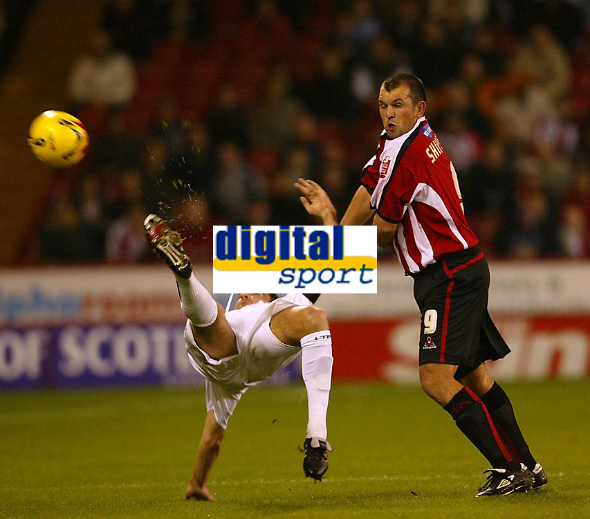 Photo: Aidan Ellis.<br /> Sheffield Utd v Luton Town. Coca Cola Championship.<br /> 01/11/2005.<br /> Luton's Chris Coyne clears the ball acrobaticly from Sheffield's Neil Shipperly