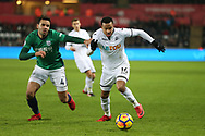Martin Olsson of Swansea city breaks away from Hal Robson-Kanu of West Bromwich Albion. Premier league match, Swansea city v West Bromwich Albion at the Liberty Stadium in Swansea, South Wales on Saturday 9th December 2017.<br /> pic by  Andrew Orchard, Andrew Orchard sports photography.