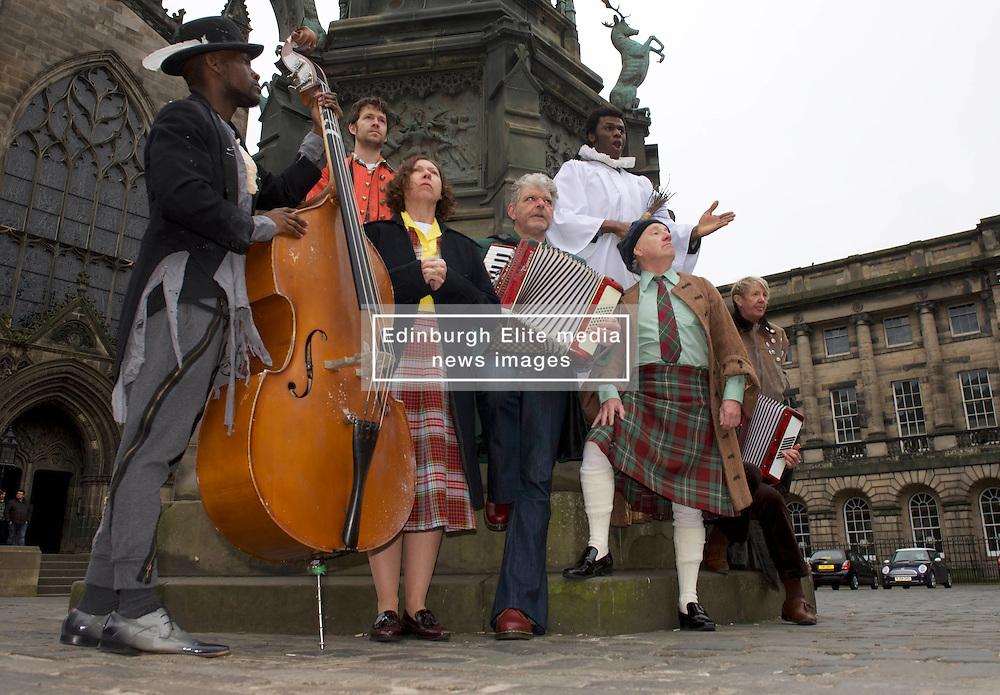 Actors perform a few songs from I am Thomas in costume in Parliament Square, Edinburgh, 23rd March 2016,Actors left to right: John Pfumojena, Dominic Marsh, Amanda Hadingue, Iain Johstone, Charlie Folorunsho, John Cobb, Hannah McPake, Myra McFadyen<br /> (c) Brian Anderson | Edinburgh Elite media