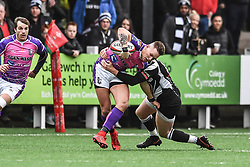 Pontypridd's Cameron Lewis is tackled by Bedwas's Ross Wardle  - Mandatory by-line: Craig Thomas/Replay images - 30/12/2017 - RUGBY - Sardis Road - Pontypridd, Wales - Pontypridd v Bedwas - Principality Premiership