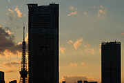 Tokyo Tower behind high-rise apartment buildings in Tokyo, Japan. Wednesday February 3rd 2021