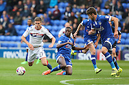 Ousmane Fané of Oldham Athletic makes a sliding challenge against Ryan Colclough of Wigan Athletic giving away a foul  during the EFL Cup match between Oldham Athletic and Wigan Athletic at Boundary Park, Oldham, England on 9 August 2016. Photo by Simon Brady.