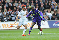 Swansea City's Neil Taylor vies for possession with Manchester City's Yaya Toure<br /> <br /> Photographer Ashley Crowden/CameraSport<br /> <br /> Football - Barclays Premiership - Swansea City v Manchester City - Sunday 17th May 2015 - Liberty Stadium - Swansea<br /> <br /> © CameraSport - 43 Linden Ave. Countesthorpe. Leicester. England. LE8 5PG - Tel: +44 (0) 116 277 4147 - admin@camerasport.com - www.camerasport.com