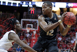 20 March 2017:  Matt Williams defended by Paris Lee(1) during a College NIT (National Invitational Tournament) 2nd round mens basketball game between the UCF (University of Central Florida) Knights and Illinois State Redbirds in  Redbird Arena, Normal IL
