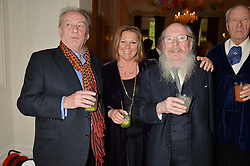 Left to right, the 17th VISCOUNT GORMANSTON, VISCOUNTESS GORMANSTON and The HON.GARECH BROWNE at a party to celebrate the publication on 'The Ape Has Stabbed Me' by Vincent Poklewski Koziell held at The Polish Club, 55 Exhibition Road, London on 1st May 2014.