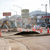 112913  Adron Gardner/Independent<br /> <br /> A construction crew breaks down a west-bound lane of Historic Highway 66 in Gallup Friday.