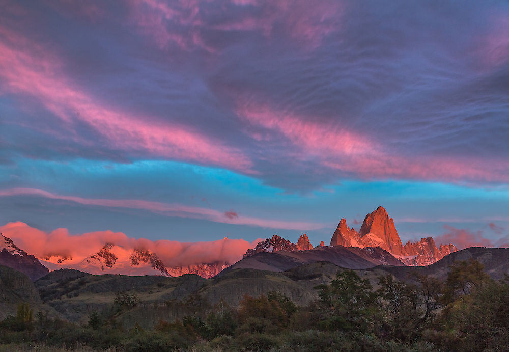 Mount Fitzroy is bathed in the sun's first light on a stunning autumn morning in Patagonia's Los Glaciares National Park.
