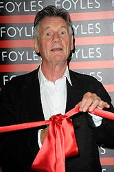 Image ©Licensed to i-Images Picture Agency. 11/06/2014. London, United Kingdom. Michael Palin opens the travel section in the new Foyles book store,  Charing Cross Road. Picture by Chris Joseph / i-Images