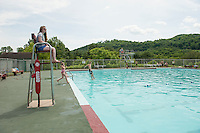 Lifeguard Katelyn Tomaselli keeps a watchful eye on swimmers at the Kiwanis Pool in St. Johnsbury Vermont.  Karen Bobotas / for Kiwanis International