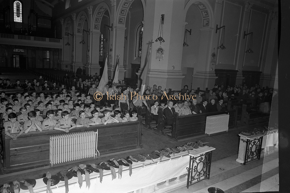 20/01/1963<br /> 01/20/1963<br /> 20 January 1963<br /> CBSI Investiture at Merchants Quay, Dublin. Investiture of 52 Scouts and 30 Macoimh, and presentation of 4 commissions to Scout Masters at the Franciscan Church. View of colour party marching up aisle of church.