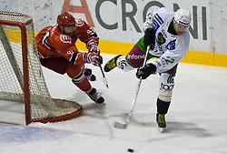 Tomo Hafner of Jesenice vs Greg Kuznik of Olimpija at 14th Round of EBEL league  ice hockey match between HK Acroni Jesenice and HDD Tilia Olimpija Ljubljana, on October 16, 2009, in Arena Podmezaklja, Jesenice. (Photo by Vid Ponikvar / Sportida)