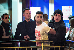 """© Licensed to London News Pictures . 16/11/2015 . Manchester , UK . Security detain a man at the event . Annual student pub crawl """" Carnage """" at Manchester's Deansgate Locks nightclubs venue . The event sees students visit several clubs over the course of an evening . This year's theme is """" Animal Instinct - unleash your beast """" . Photo credit : Joel Goodman/LNP"""