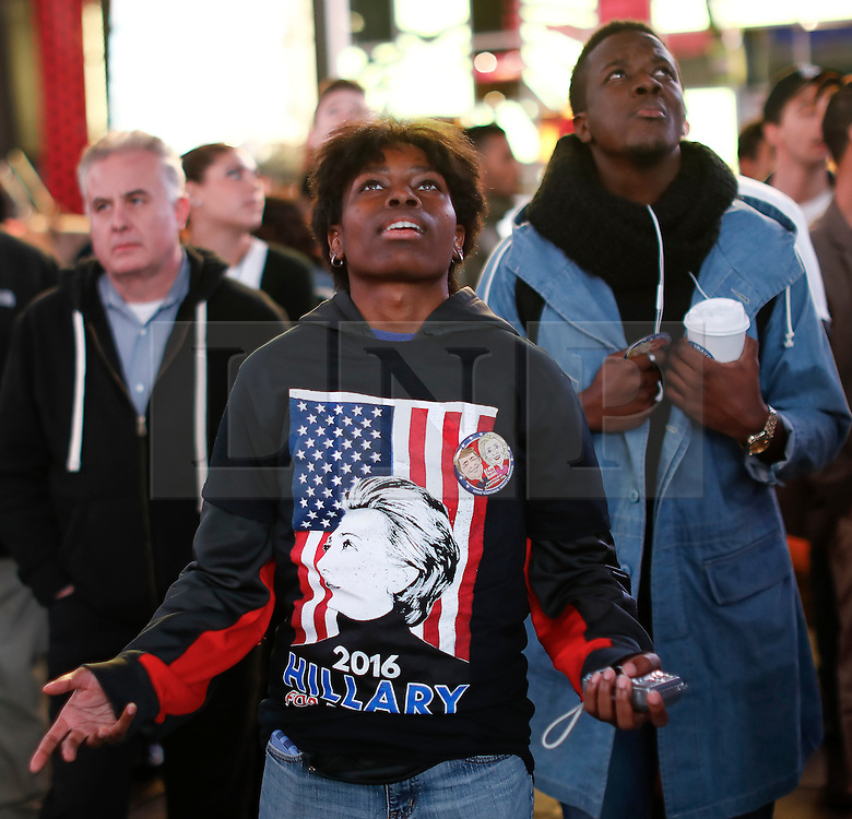 © Licensed to London News Pictures. 09/11/2016. New York City, USA. A Hilary Clinton supporter gestures in disappointment as she reacts to news that Donald Trump looks likely to be elected as the next president of the United States, while gathering in Times Square, New York City, on Wednesday, 9 November. Photo credit: Tolga Akmen/LNP