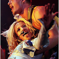 Britney Spears falls into the arms of one of her dancers to let the audience at Desert Sky Pavillion in Phoenix, AZ.
