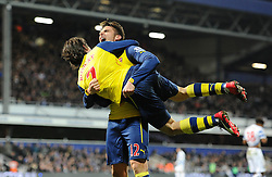 Arsenal's Olivier Giroud celebrates his goal with Arsenal's Tomas Rosicky - Photo mandatory by-line: Dougie Allward/JMP - Mobile: 07966 386802 - 04/03/2015 - SPORT - football - London - Loftus Stadium - Queens Park Rangers v Arsenal - Barclays Premier League