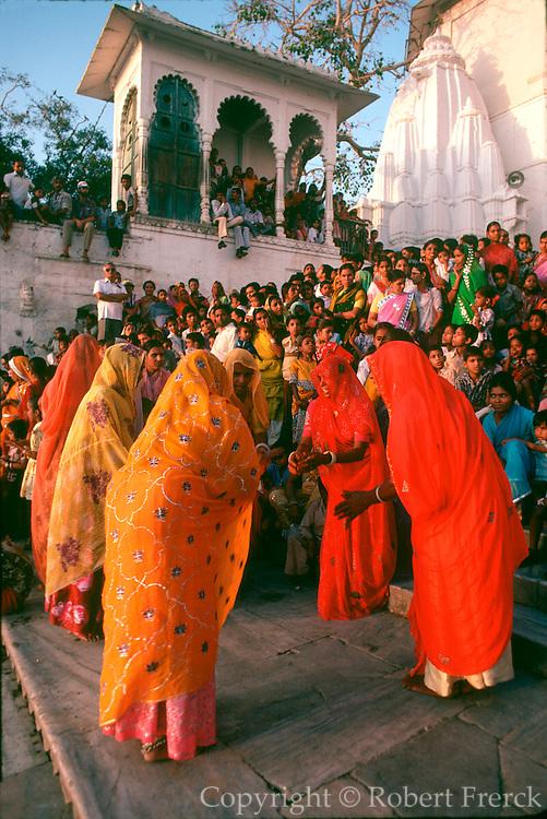 INDIA, FESTIVALS Gangaur, Hindu festival for Parvati, consort of Siva. Females dancing in Udaipur.