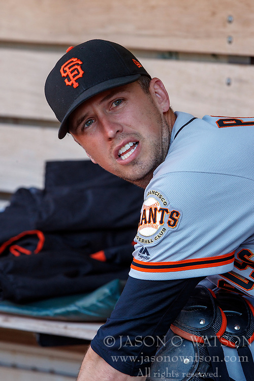 OAKLAND, CA - JULY 20:  Buster Posey #28 of the San Francisco Giants sits in the dugout before the game against the Oakland Athletics at the Oakland Coliseum on July 20, 2018 in Oakland, California. The San Francisco Giants defeated the Oakland Athletics 5-1. (Photo by Jason O. Watson/Getty Images) *** Local Caption *** Buster Posey