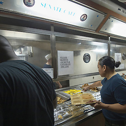 USS John C Stennis CVN-74 Aircraft Carrier.Pic Shows Crew members ligning up for food