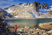 Hiker at Isolation Lake in the Upper Enchantment Lakes area of the Alpine Lakes Wilderness, Washington