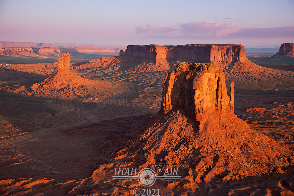 East Mitten Butte front right with West Mitten Butte and Sentinal Mesa in the background. Looking west in Monument Valley