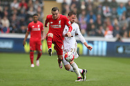 Brad Smith of Liverpool (l) gets to the ball ahead of Gylfi Sigurdsson of Swansea city (r). Barclays Premier league match, Swansea city v Liverpool  at the Liberty Stadium in Swansea, South Wales on Sunday 1st May 2016.<br /> pic by  Andrew Orchard, Andrew Orchard sports photography.