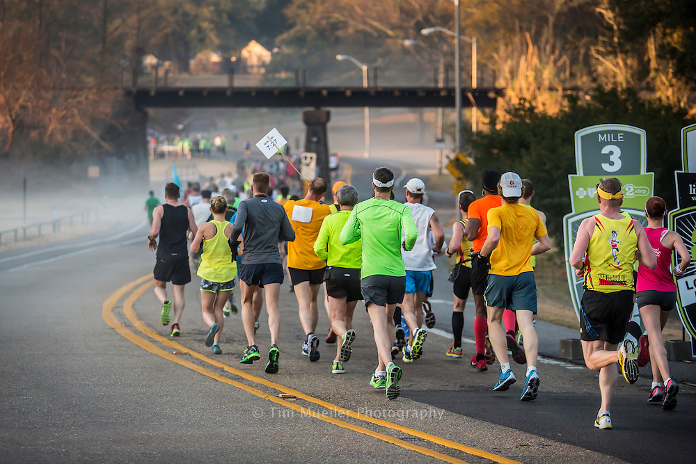 Louisiana Marathon participants race down Dalrymple Avenue near the mile 3 marker at City Park in Baton Rouge, La. Nearly 4,000 runners competed in Sunday's marathon and half-marathon races.